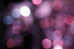 Luzes coloridas efervescentes do efeito obscuro do alargamento da lente fotografia de stock