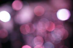 Luzes coloridas efervescentes do efeito obscuro do alargamento da lente foto de stock royalty free