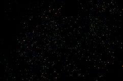 Luzes coloridas em um fundo preto fotos de stock