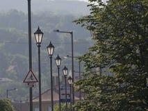 Luzes da cidade que iluminam-se no nascer do sol fotografia de stock royalty free