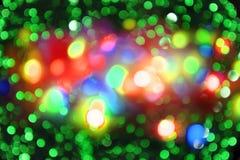 Luzes da cor do Natal como o fundo do feriado Fotografia de Stock