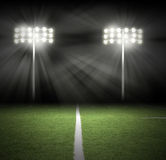 Luzes da noite do jogo do estádio no preto Fotografia de Stock Royalty Free