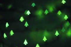 Luzes dadas forma da árvore de Natal, bokeh Fotografia de Stock