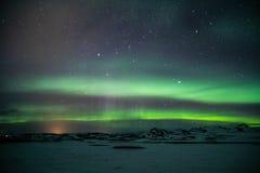 Luzes de Aurora Borealis /Northern acima de Islândia fotos de stock