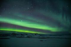 Luzes de Aurora Borealis /Northern acima de Islândia foto de stock royalty free