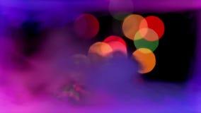 Luzes de Bokeh no fumo colorido video estoque