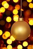 Luzes de incandescência do ornamento e do feriado do Natal do ouro Imagens de Stock