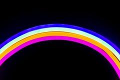 Luzes de néon coloridas dadas forma como um arco-íris foto de stock royalty free