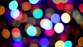 Luzes de Natal coloridas do twinkling do fundo de Bokeh multi video filme