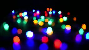 Luzes de Natal Defocused que geram o efeito do bokeh filme