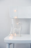 Luzes de Natal e cervos cerâmicos Foto de Stock Royalty Free