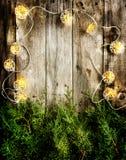Luzes de Natal na madeira Imagens de Stock Royalty Free