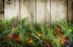 Luzes de Natal na madeira fotografia de stock