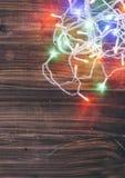 Luzes de Natal na madeira Fotos de Stock