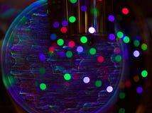 Luzes de Natal refletindo do pulso de disparo Imagens de Stock Royalty Free