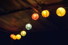 Luzes de suspensão após o por do sol Fotos de Stock Royalty Free