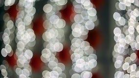 Luzes Defocused da partícula do diodo emissor de luz que piscam na noite vídeos de arquivo