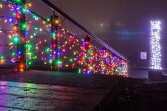 Luzes do feriado na névoa Imagens de Stock