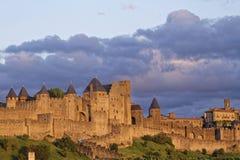Luzes do por do sol nas paredes de Carcassonne Foto de Stock