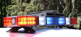 Luzes do telhado do carro de polícia imagens de stock royalty free