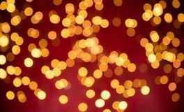 Luzes douradas abstratas borradas do ponto Imagens de Stock