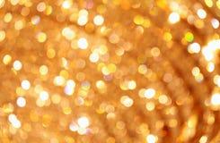 Luzes douradas abstratas Defocused Fotografia de Stock Royalty Free