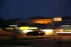 Luzes e carro borrados Foto de Stock Royalty Free