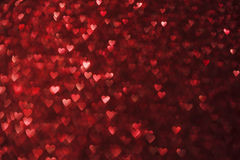 Luzes fundo dos corações, Sparkles do vermelho da forma do coração Fotos de Stock Royalty Free