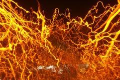 Luzes moventes alaranjadas Fotografia de Stock Royalty Free