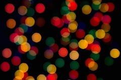 luzes Multi-coloridas em um fundo escuro Fotografia de Stock Royalty Free