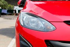 Luzes principais de um carro Fotos de Stock Royalty Free