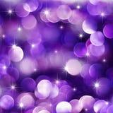 Luzes roxas do feriado foto de stock