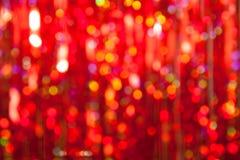 Luzes vermelhas do Natal abstrato no fundo Imagens de Stock Royalty Free