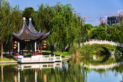 Luzhi Ancient Town Suzhou China. Luzhi ancient town, China. August 1, 2015. A Chinese gazebo on a small lake within the Luzhi Ancient Town scenic area with a new stock photography