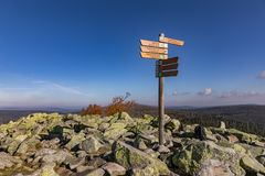 Luzny, Sumava. Lusen, Bavaria, Germany. Tourist signpost at the top of Luzny Hill. Colorful autumn in mountain Sumava. Germany Royalty Free Stock Photography