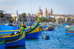 Luzzu anchored at the port of Marsaxlokk Royalty Free Stock Photos
