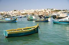 Luzzu boats harbor marsaxlokk malta. Luzzu fishing maltese boats in harbor of marsaxlokk old fishing village malta mediterranean sea royalty free stock images