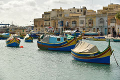 Luzzu boats Marsaxlokk Harbor Malta. Luzzu fishing maltese boats in harbor of marsaxlokk old fishing village malta mediterranean sea Royalty Free Stock Images