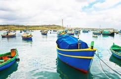 Luzzu colored boats at Marsaxlokk Bay in Malta. Island Royalty Free Stock Photo
