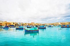 Luzzu colored boats at Marsaxlokk Bay on Malta Royalty Free Stock Images