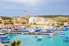 Luzzu colored boats at Marsaxlokk Harbor in Malta. Island Stock Photography