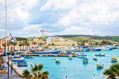 Luzzu colored boats at Marsaxlokk Harbor on Malta. Island Stock Images
