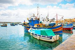 Luzzu colored boats at Marsaxlokk Harbor at Malta Royalty Free Stock Images