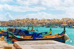 Luzzu colorful boats at Marsaxlokk Bay on Malta. Island Royalty Free Stock Photos