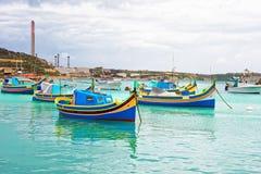 Luzzu colorful boats at Marsaxlokk Harbor of Malta. Island Stock Image