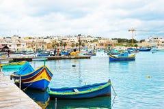 Luzzu colorful boats at Marsaxlokk Harbor at Malta. Island Stock Photo