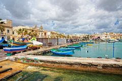 Luzzu colorful boats on Marsaxlokk Harbor Malta Stock Photos