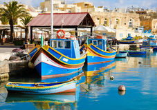 Luzzu famous fishing boats in Marsaxlokk - Malta.  Stock Photos