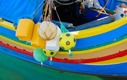 Luzzu famous fishing boats in Marsaxlokk - Malta Royalty Free Stock Photos
