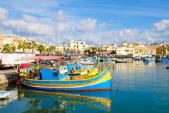 Luzzu fishing boats in Marsaxlokk - Malta Stock Photo